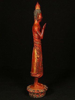 Antique standing Laos Buddha statue
