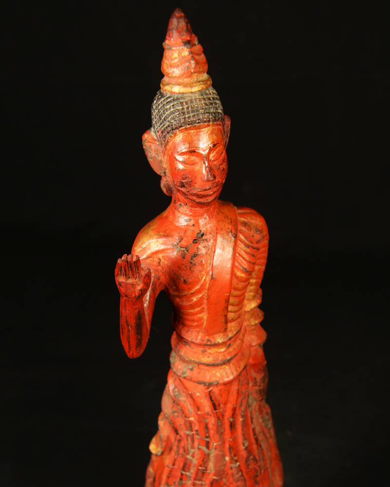 Antique standing Laos Buddha statue from Laos made from Wood