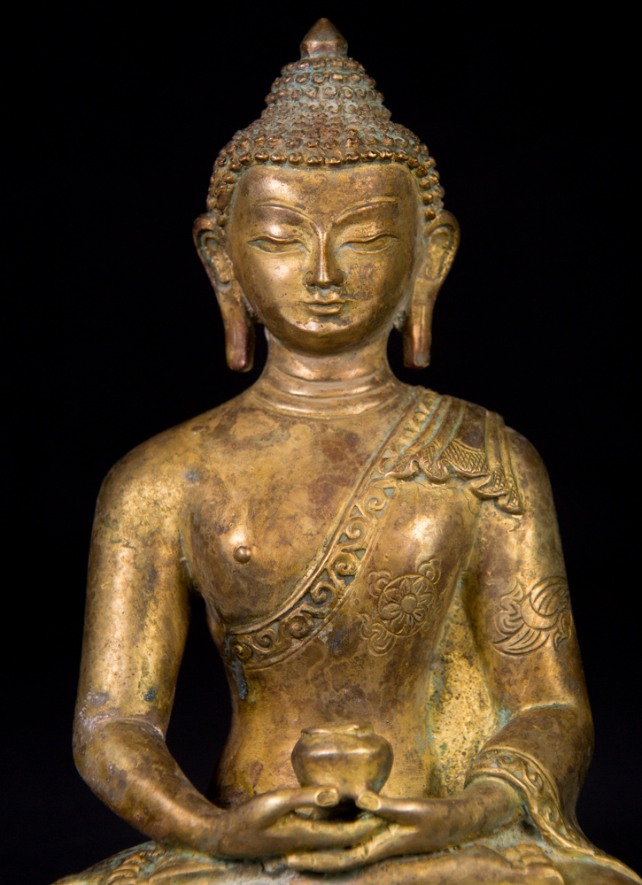 Old Nepali Buddha statue from Nepal made from Bronze