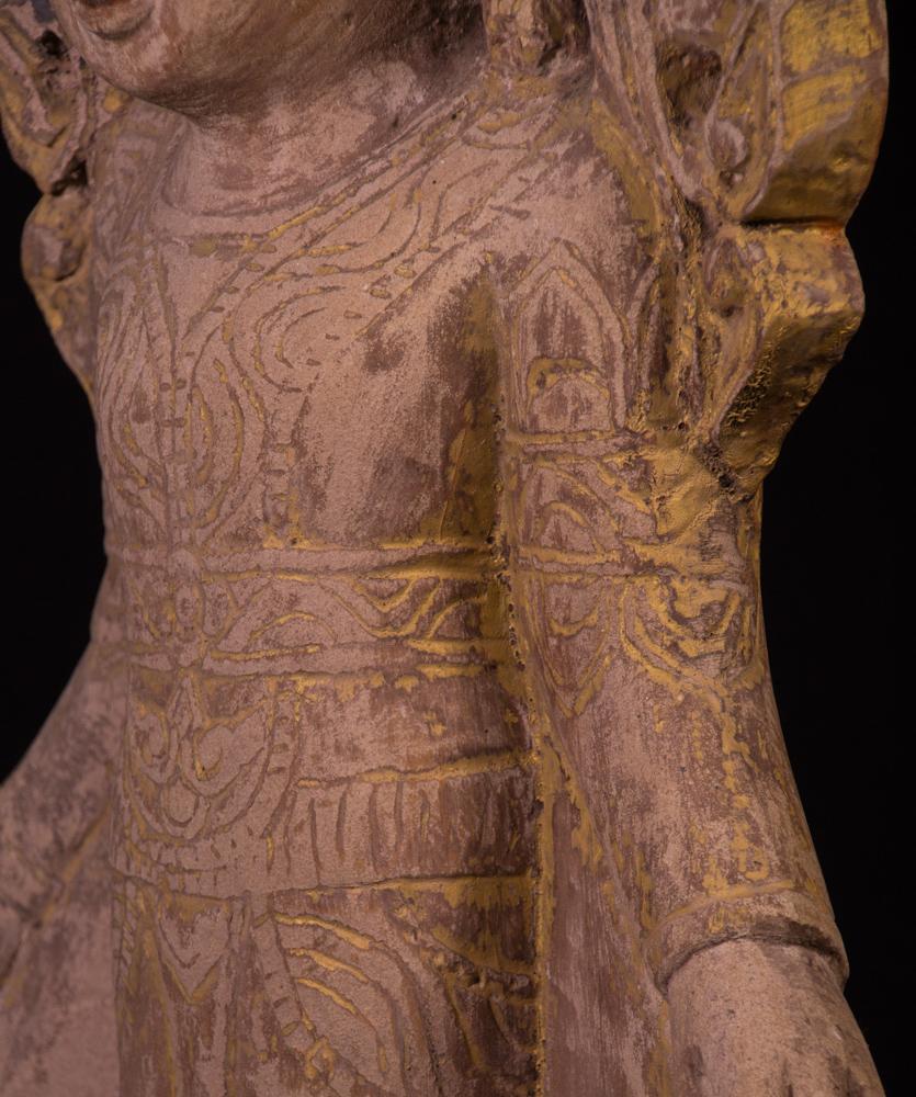 Old sandstone Buddha statue