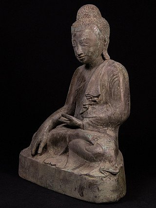 Old bronze Mandalay Buddha statue