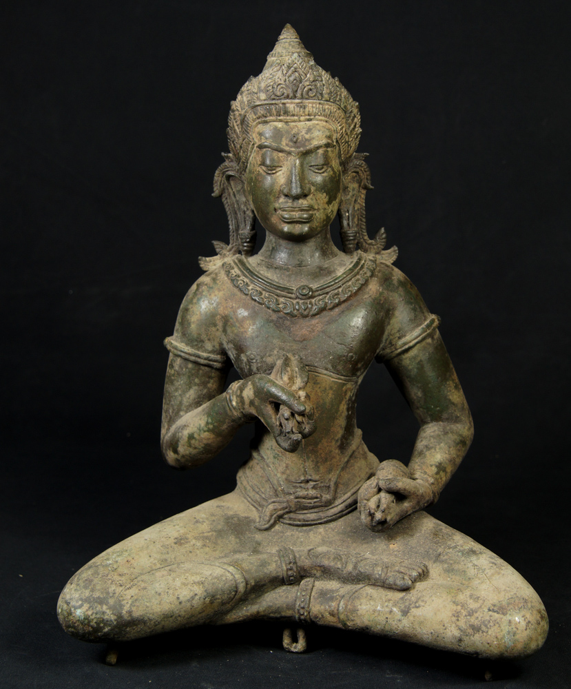 Old bronze Khmer Buddha statue from Cambodia
