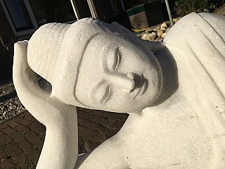 Newly made marble reclining Buddha statue