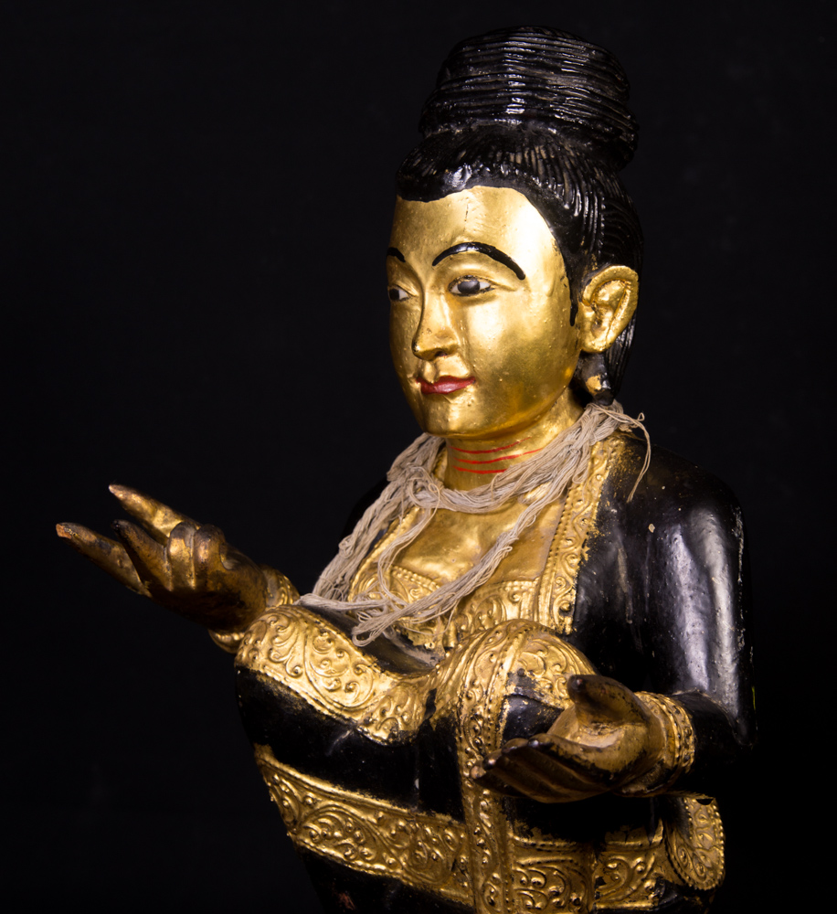 Old Burmese Nat statue from Burma made from Wood