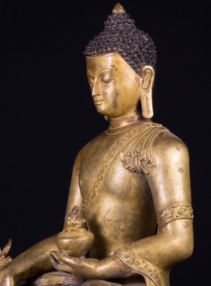 Old Nepali medicine Buddha statue from Nepal made from Bronze