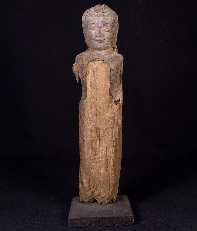 Antique wooden Buddha fragment on base