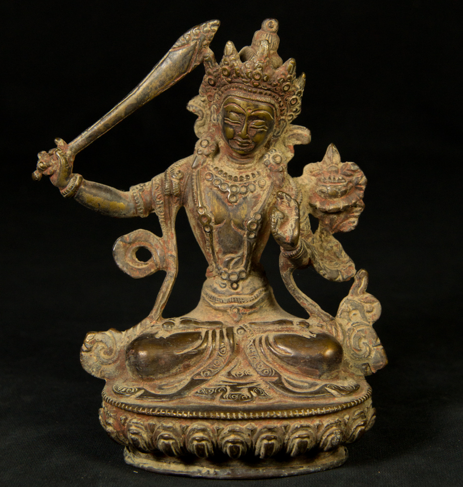 Old Manjushree statue from Nepal made from Bronze