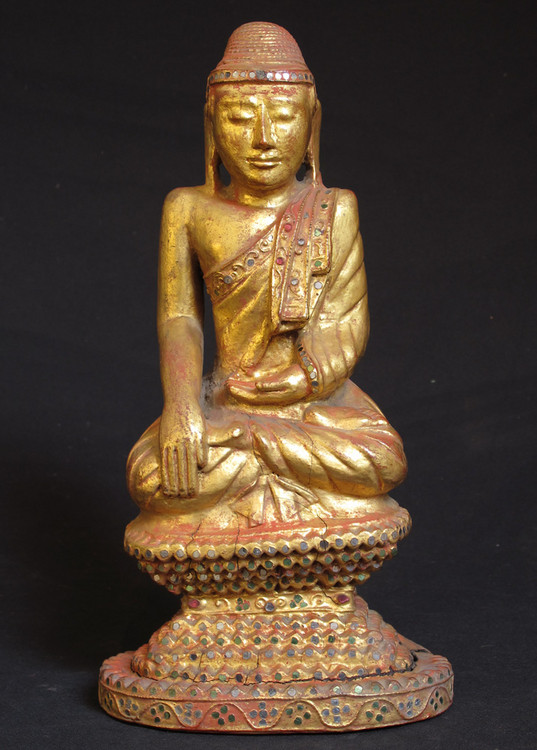 Antique Buddha statue from Burma made from Wood