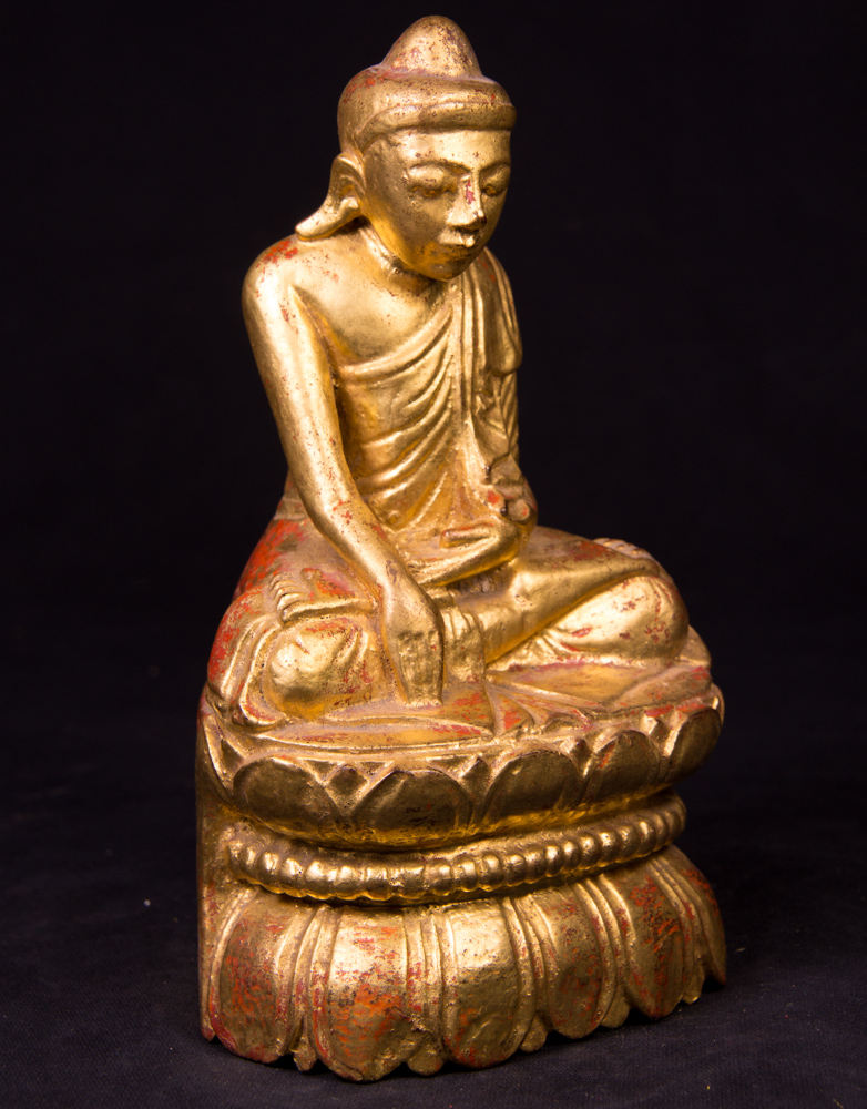 Antique wooden Buddha statue from Burma made from Wood