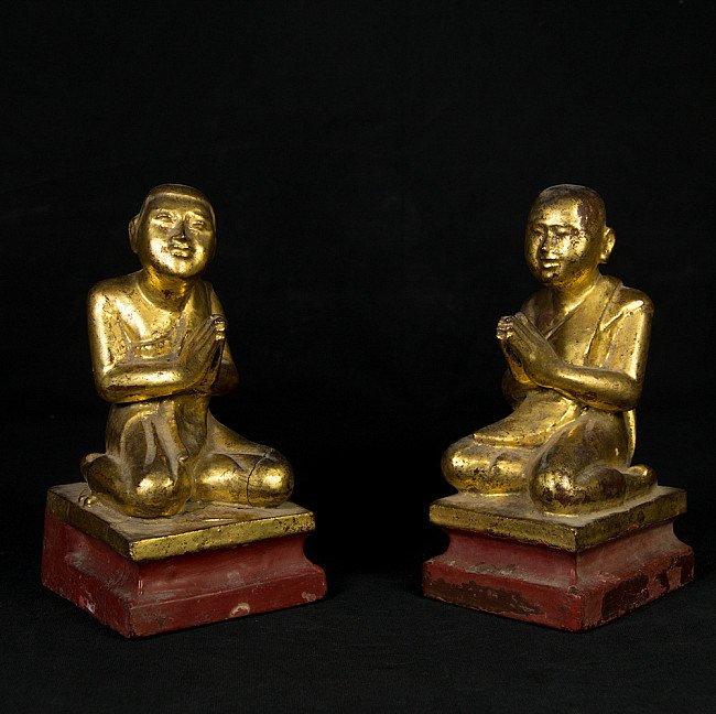Pair of antique monk statues