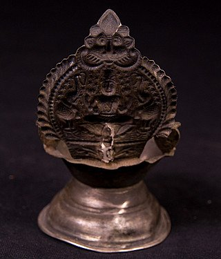 Antique silver oil lamp