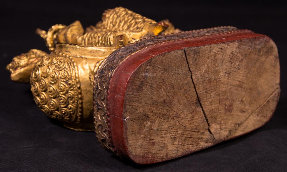 Antique wooden Hintha bird