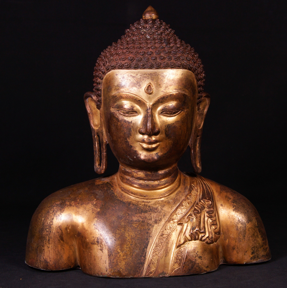 Old bronze Buddha head from Nepal