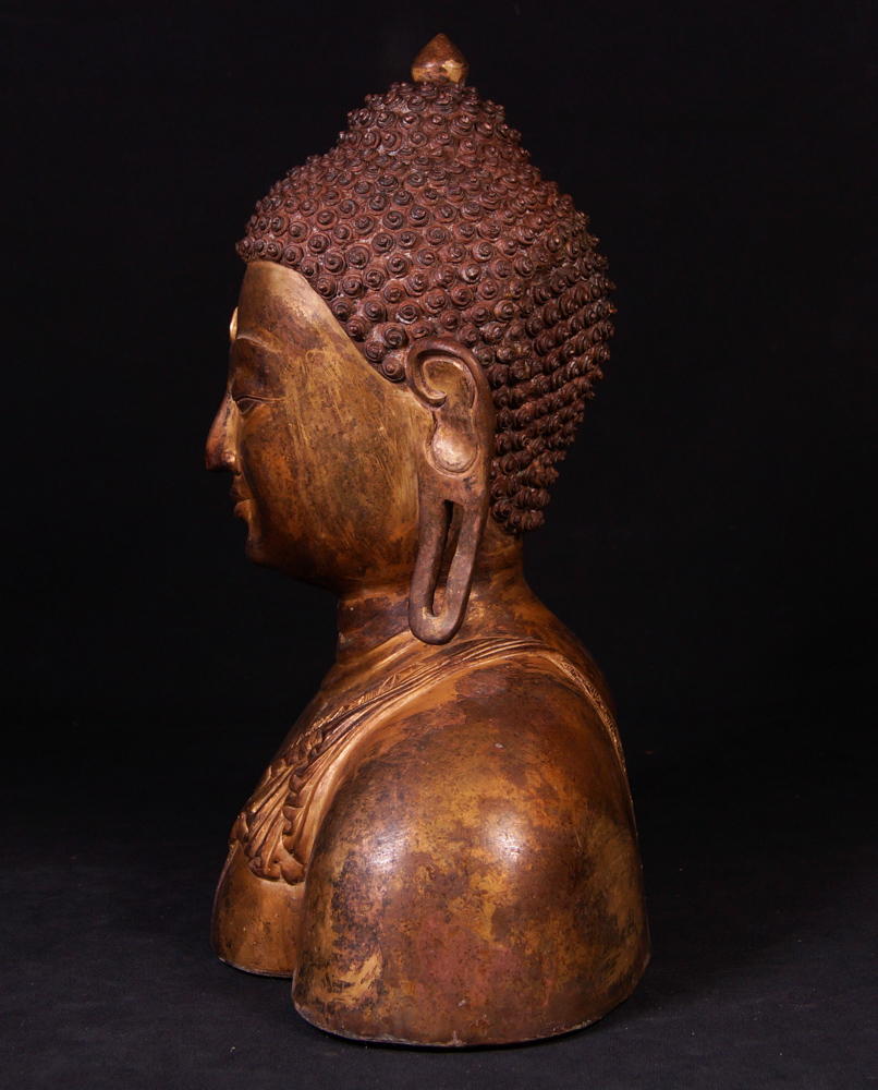 Old bronze Buddha head from Nepal made from Bronze