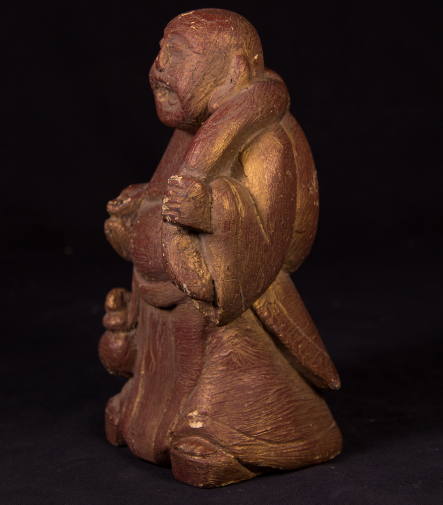 Old happy Buddha statue from Burma made from Wood