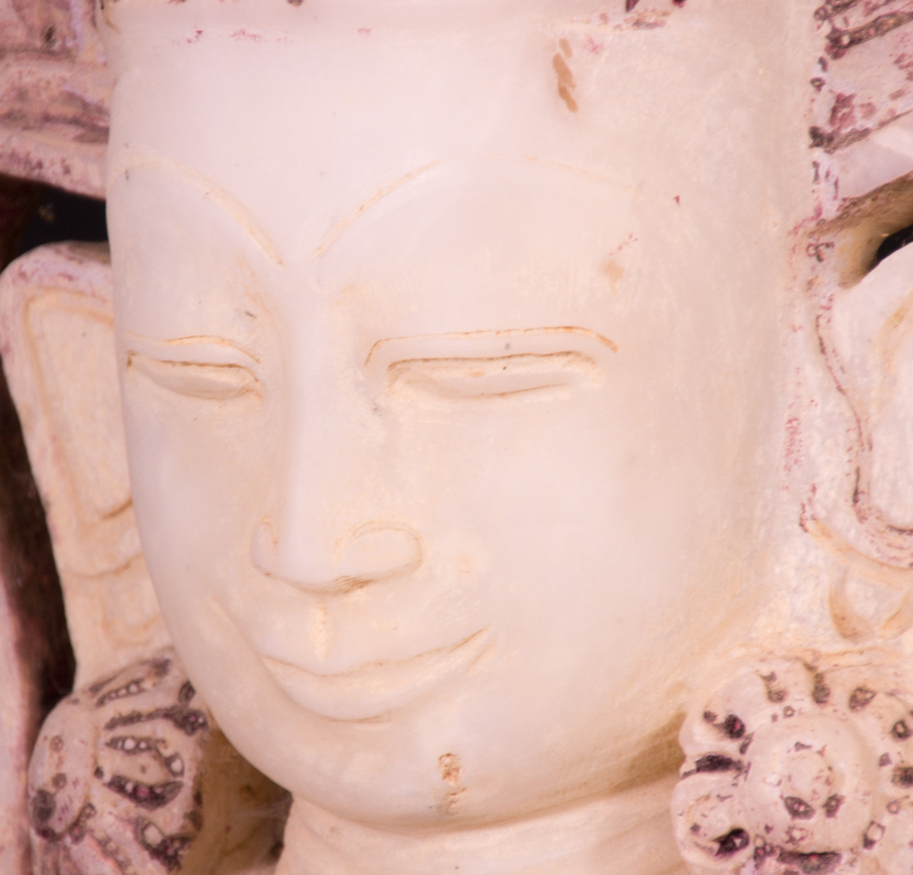 Old marble crowned Buddha statue