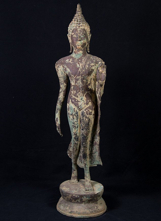 Antique standing Thai Buddha statue