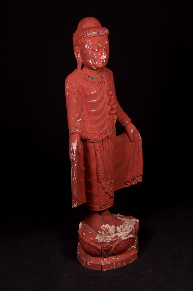Old standing Buddha statue from Burma made from Wood