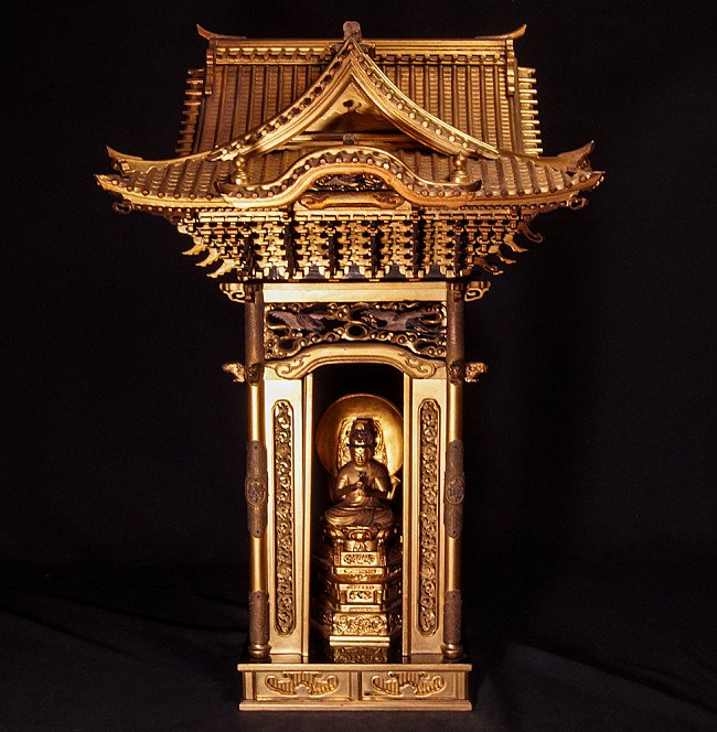 Antique Japanese temple shrine with Buddha statue