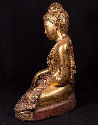 Oude houten Mandalay Boeddha