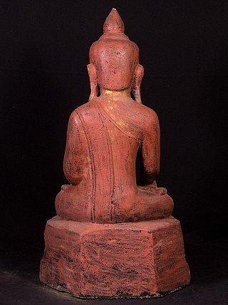Antique sandstone Buddha statue