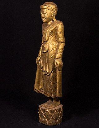 Antique standing Mandalay Buddha statue