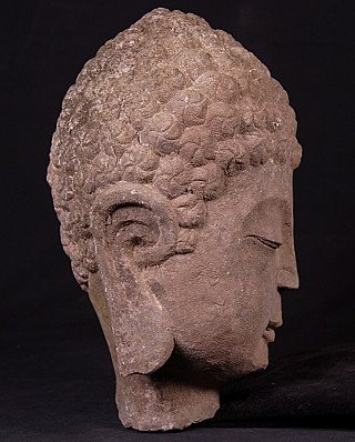Old stone Buddha head
