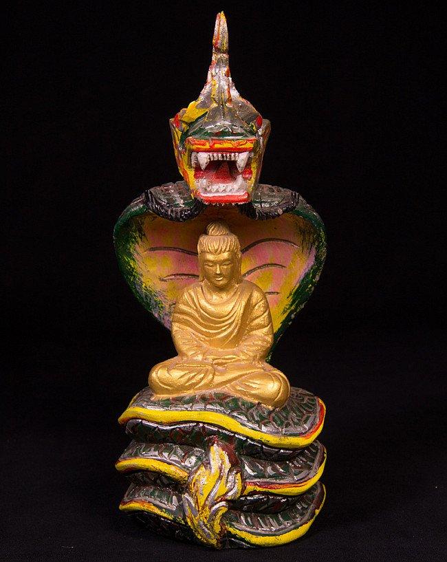 Old Buddha statue on Naga snake