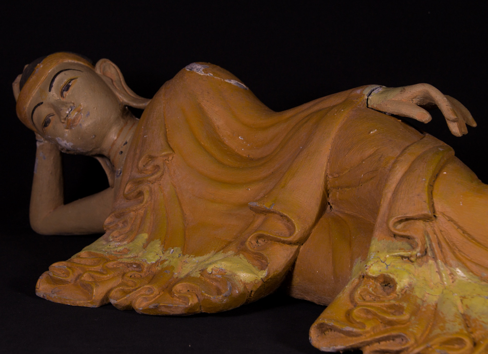 Old wooden reclining Buddha statue from Burma made from Wood