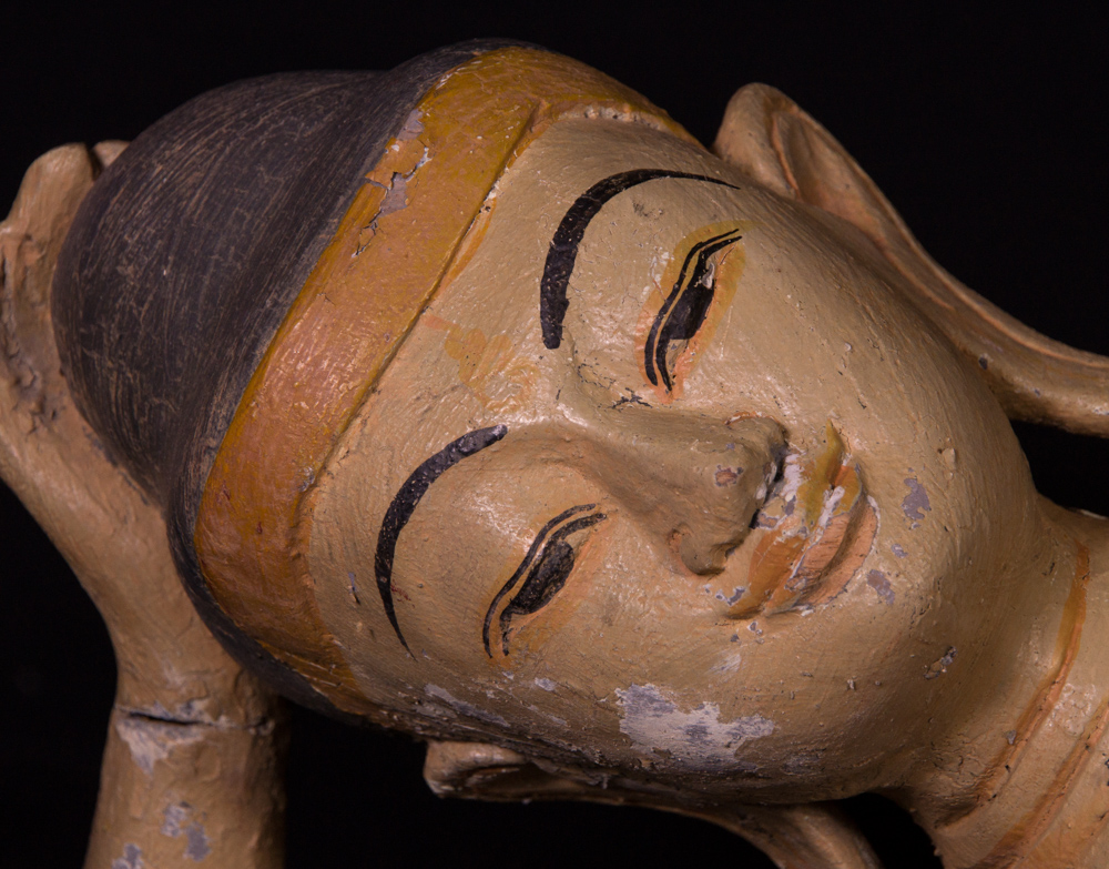 Old wooden reclining Buddha statue