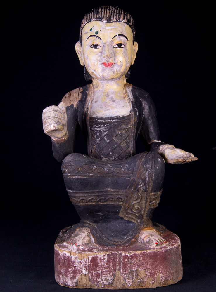 Antique wooden statue of a Burmese woman from Burma