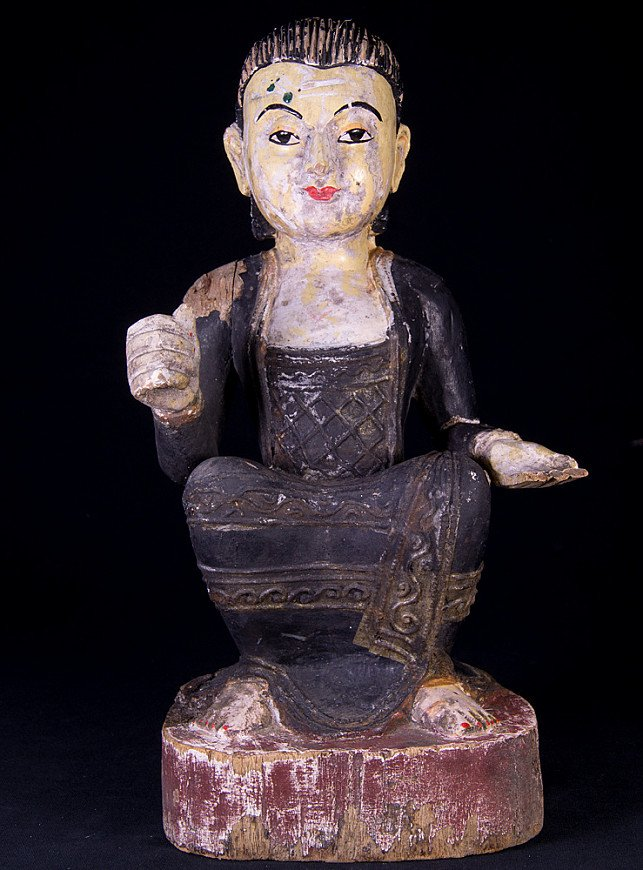 Antique wooden statue of a Burmese woman