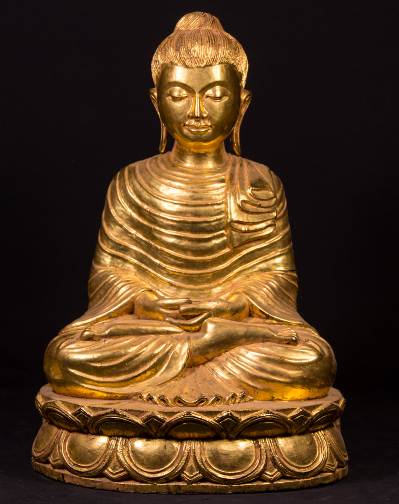 Old gilded wooden Buddha statue from Burma