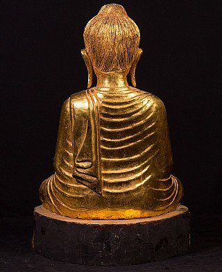 Old gilded wooden Buddha statue