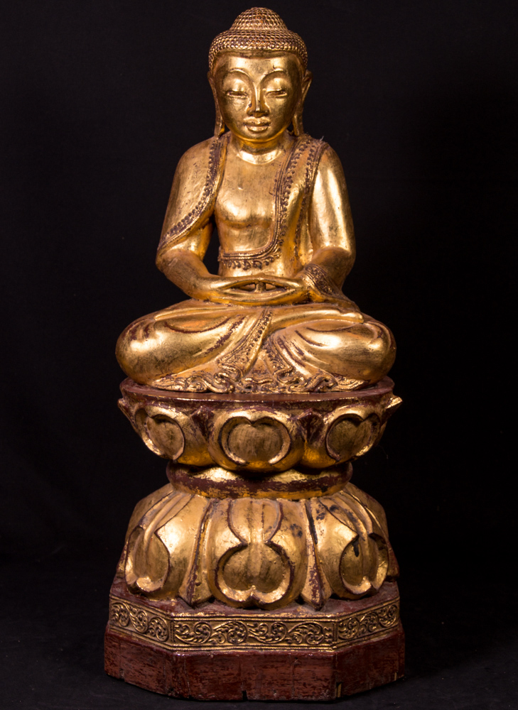 Old teak wooden Buddha statue from Burma