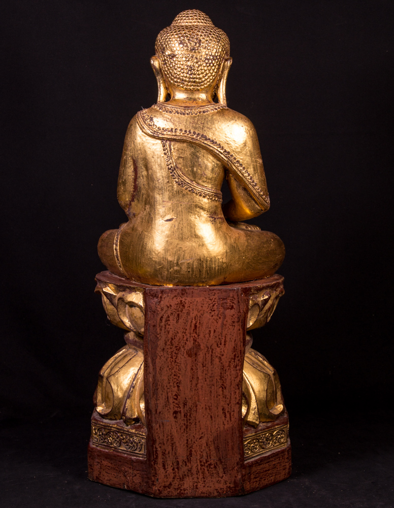Old teak wooden Buddha statue from Burma made from Wood