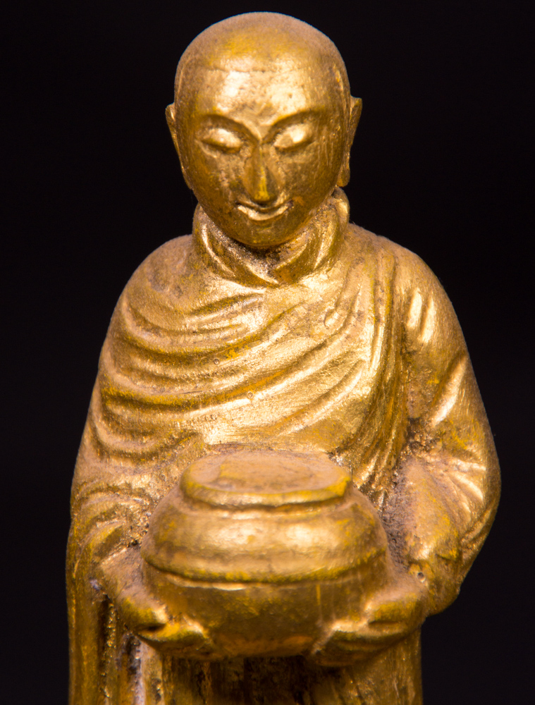 Old Buddha with 3 monk statues