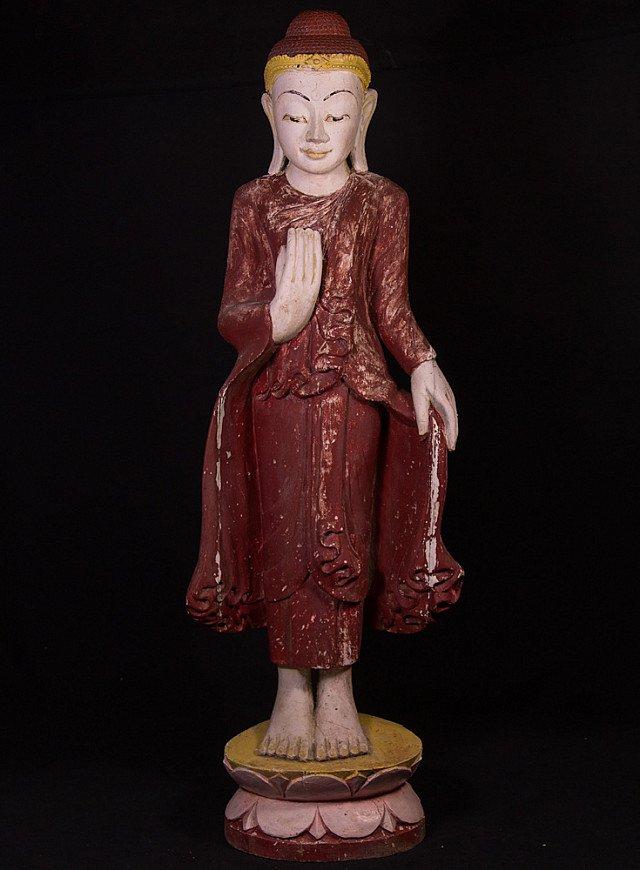 Oude staande houten Boeddha