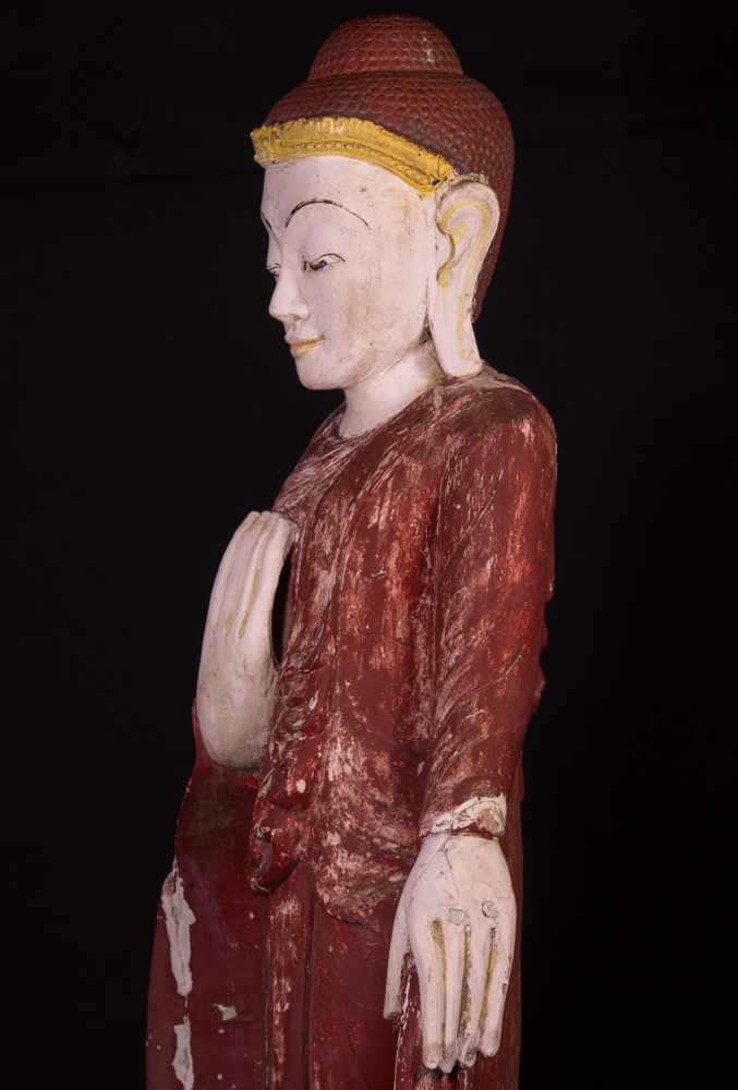 Old wooden standing Buddha statue from Burma made from Wood