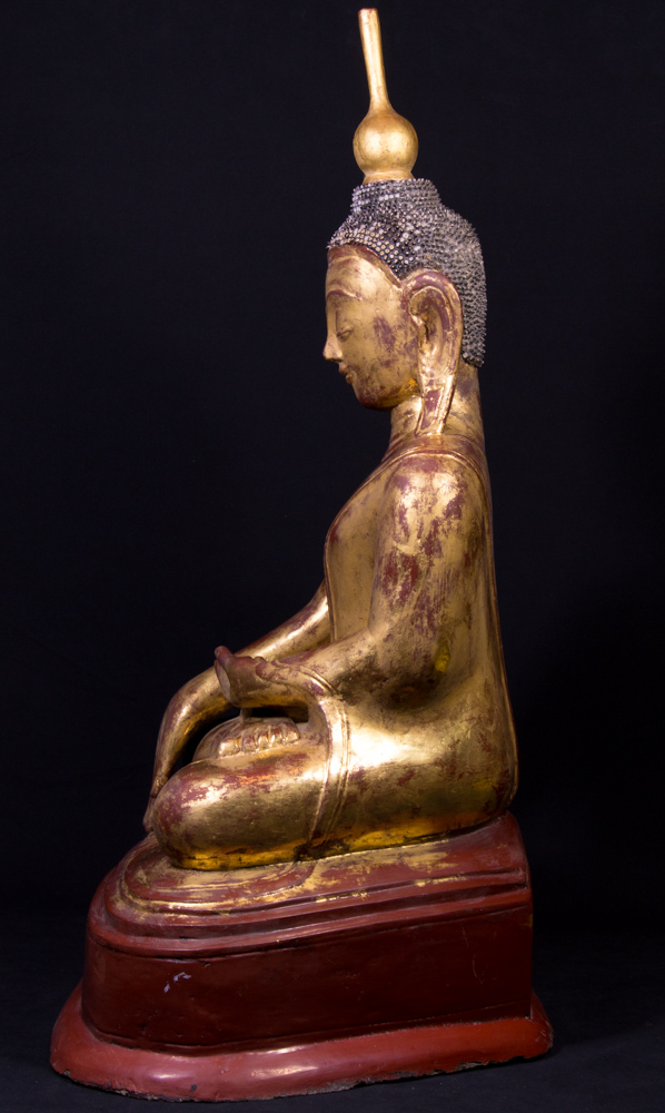 Antique crowned Buddha statue from Burma made from Wood