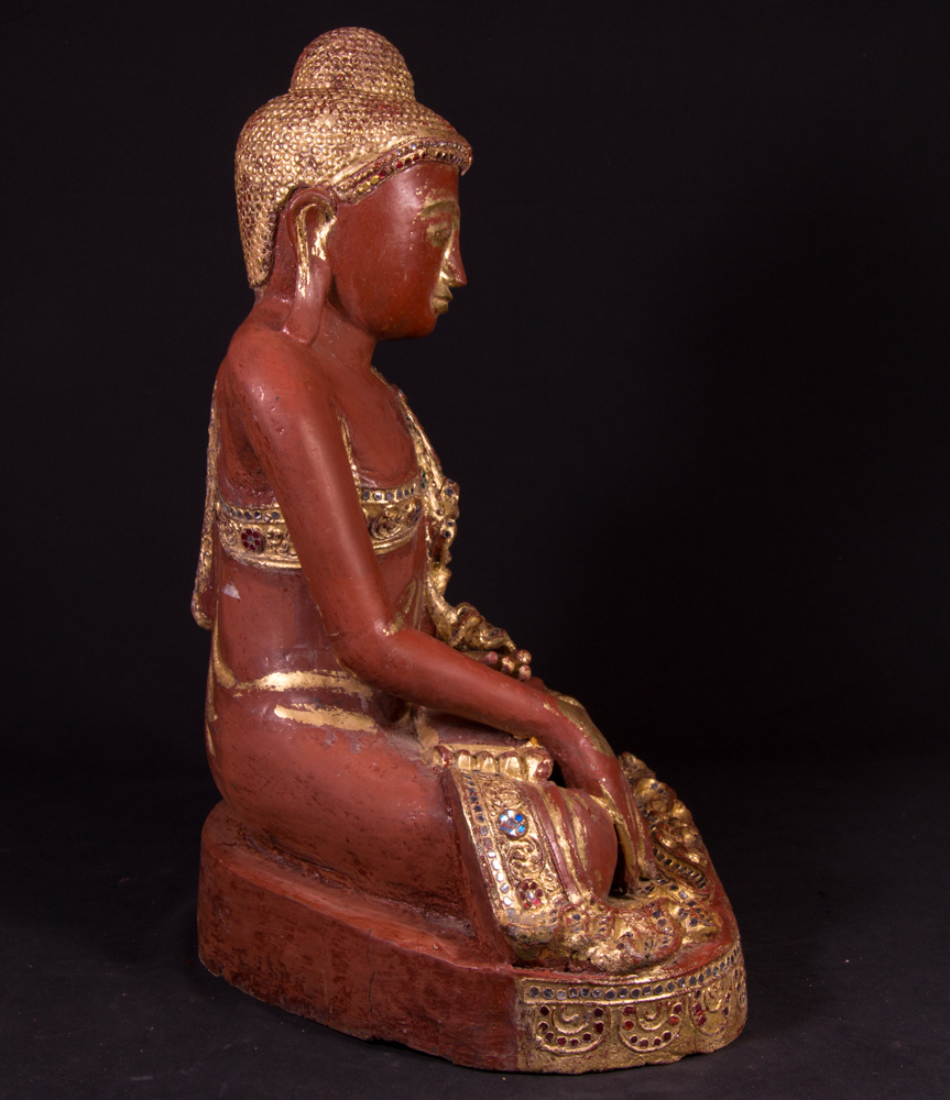 Old Burmese Buddha statue from Burma made from Wood