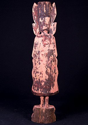 Antique wooden crowned Buddha statue