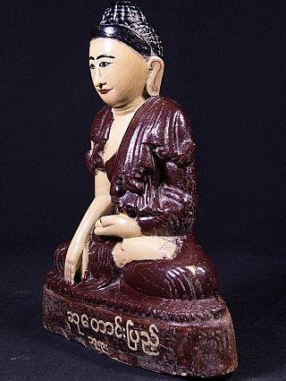 Old limestone Buddha statue