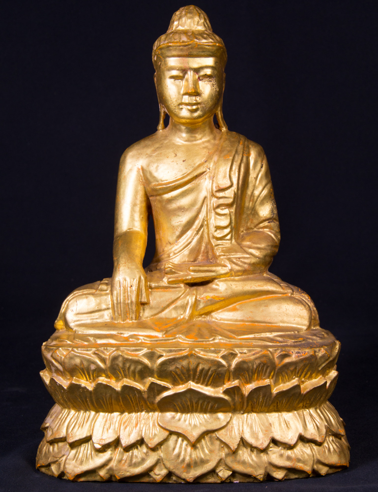 Old gilded Buddha statue from Burma