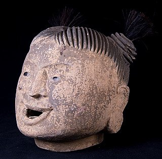 Old head of Burmese puppet