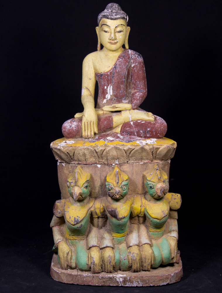 Old wooden Buddha statue on Garuda birds from Burma