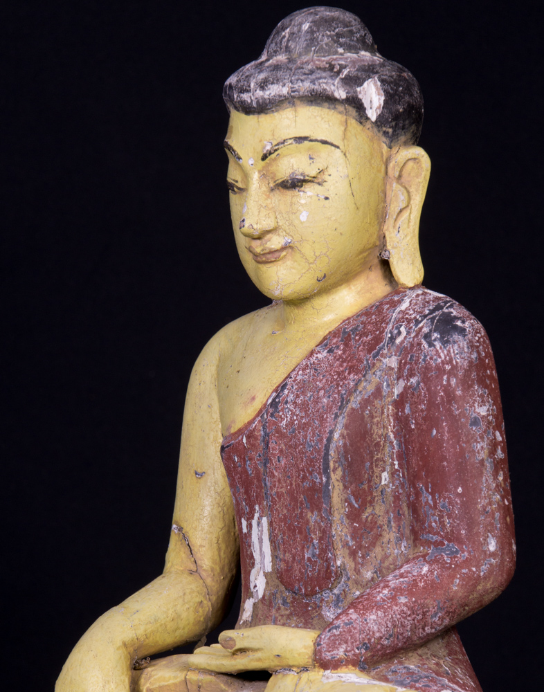 Old wooden Buddha statue on Garuda birds from Burma made from Wood