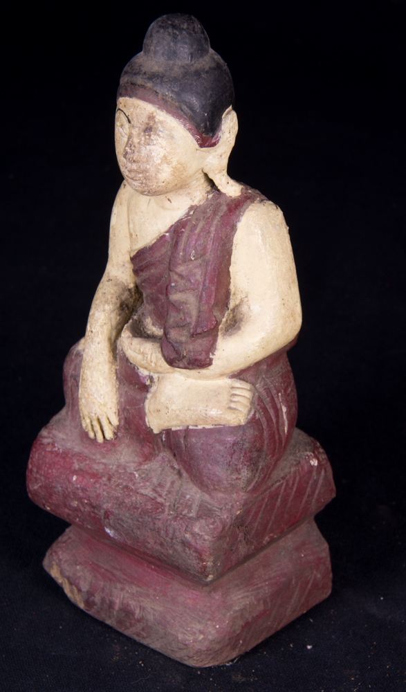 Small antique Buddha statue from Burma made from Wood