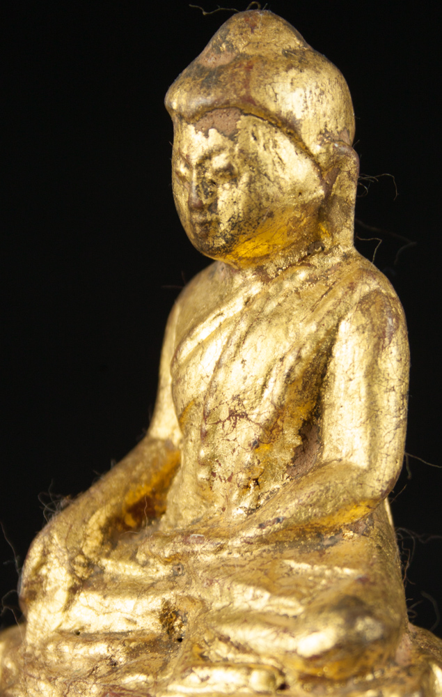 Old gilded Burmese Buddha statue from Burma made from Wood