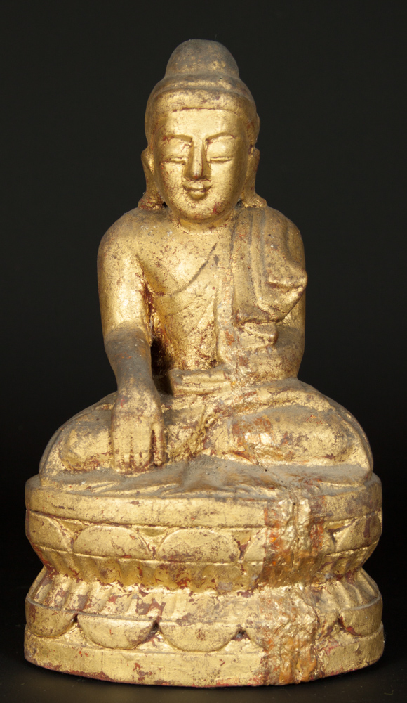 Old gilded Buddha statue from Burma made from Wood